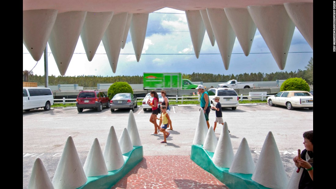 People walk past Gatorland's signature entrance in 2004.