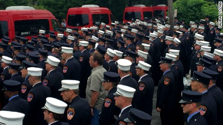 Firefighters line up to pay respect to battalion  Chief Lawrence Stack.