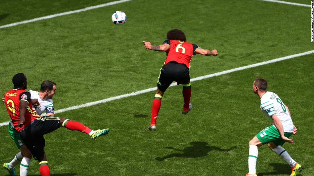 Axel Witsel of Belgium heads the ball to score his team's second goal.