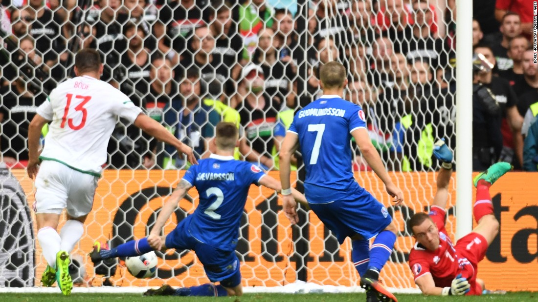 Iceland defender Birkir Saevarsson, center, scores an own goal.