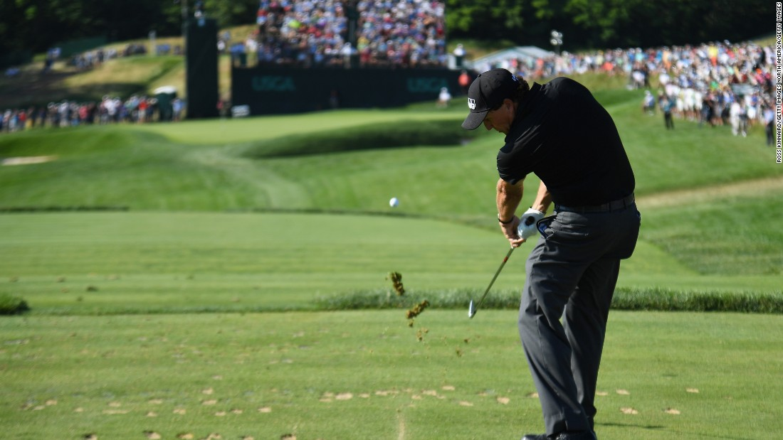 Phil Mickelson hits his tee shot on the sixth hole during the second round on June 17.
