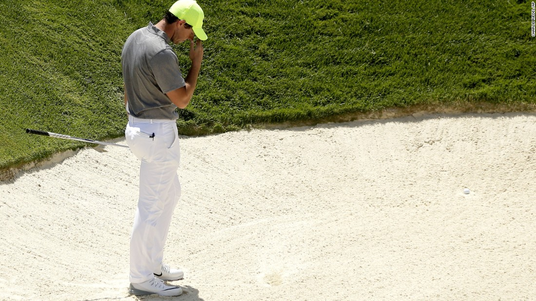 Rory McIlroy reacts after leaving his first bunker shot in the sand on the ninth hole during the second round on June 18.