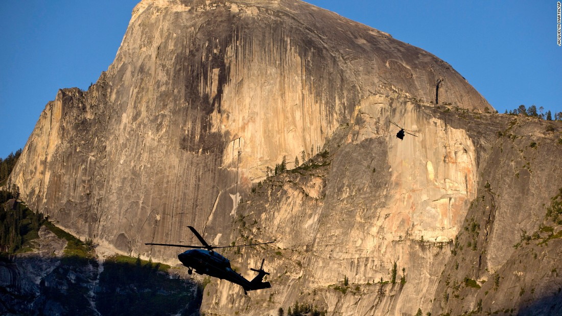 "The Marine One helicopter carrying President Barack Obama, first lady Michelle Obama, and daughters Malia and Sasha, and a support helicopter are silhouetted against the Half Dome rock formation at sunset as the first family <a href=""http://www.cnn.com/2016/06/18/politics/barack-obama-climate-change-yosemite/index.html"" target=""_blank"">arrives at Yosemite National Park</a> in California, Friday, June 17. The Obama family traveled to Carlsbad Caverns National Park in New Mexico before heading to Yosemite to celebrate the 100th anniversary of the National Park Service."