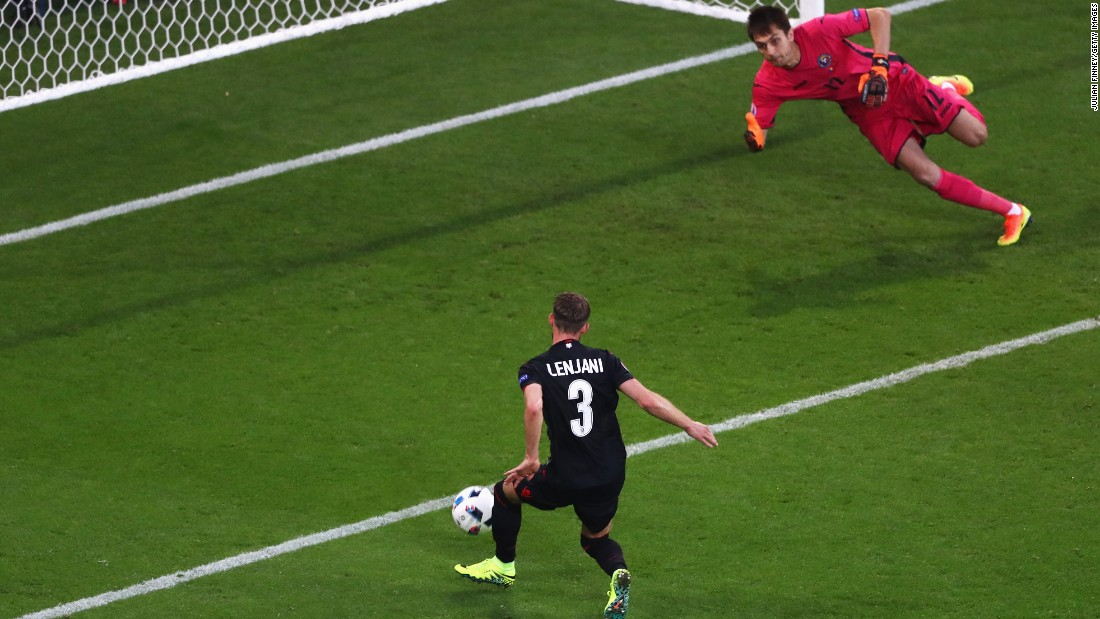 Ermir Lenjani of Albania misses a chance to score.