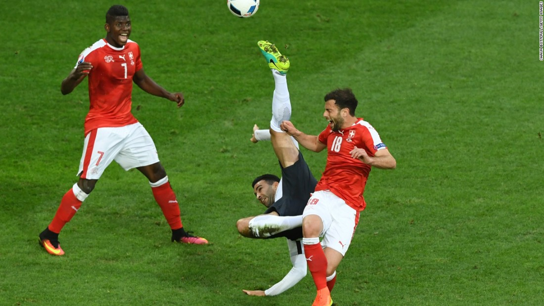 Adil Rami of France attempts an overhead kick while Admir Mehmedi of Switzerland tries to block during their match at Stade Pierre-Mauroy on Sunday in Lille, France. The game ended in a 0-0 draw.