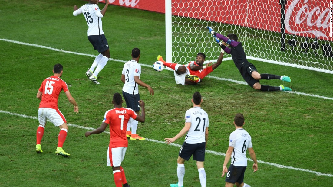 Johan Djourou of Switzerland clears the ball off the goal line.