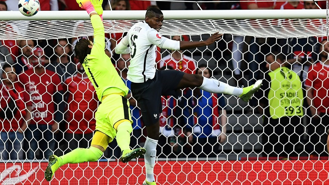 Switzerland's goalkeeper Yann Sommer jumps for the ball against France's midfielder Paul Pogba.