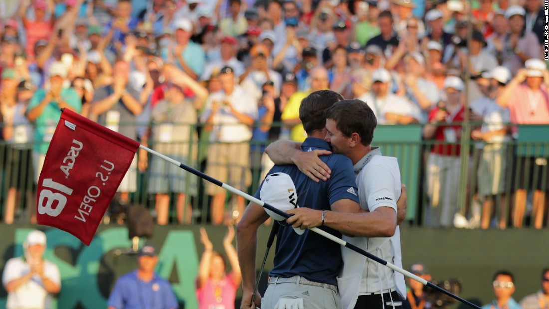 Johnson celebrates with caddie Austin Johnson on June 19.