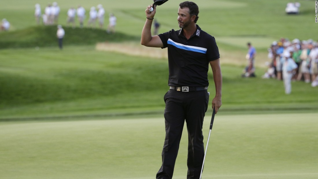 Scott Piercy waves after finishing the 18th hole on June 19.