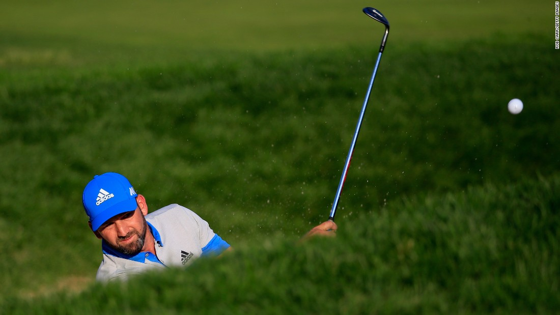 Sergio Garcia of Spain plays out of the bunker on the 16th hole on June 19.