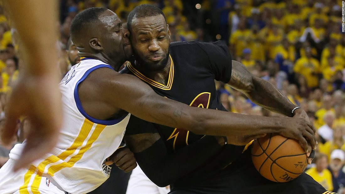 James is defended by Draymond Green in the second half.