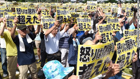 "Demonstrators hold placards that read ""our fury has gone beyond the limit"" during a rally against the US military presence in Naha, Okinawa prefecture on June 19, 2016, following the alleged rape and murder of a local woman by a former US marine and a civilian worker employed on the US military base.   Thousands of demonstrators rallied on the Japanese island of Okinawa on June 19 against the heavy US military presence and violent crimes by American personnel that have angered residents for decades. / AFP / TORU YAMANAKA        (Photo credit should read TORU YAMANAKA/AFP/Getty Images)"