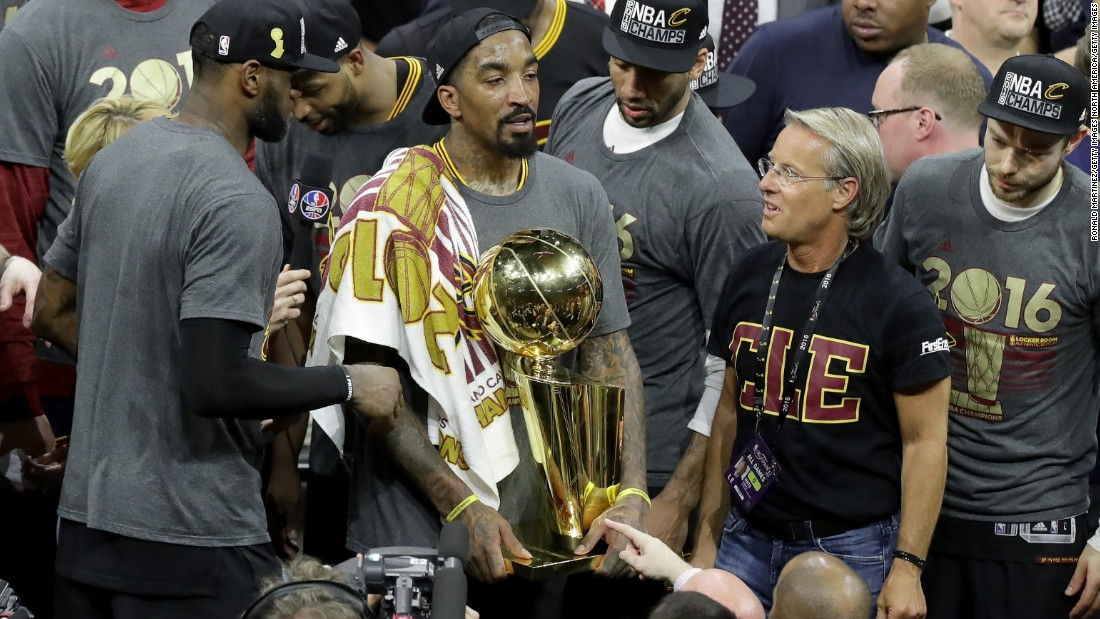 J.R. Smith (with trophy) of the Cleveland Cavaliers holds the Larry O'Brien Championship Trophy. Smith broke down in tears during the post-game press conference when asked about his relationship with his father. The Cavaliers won the championship on Father's Day in the U.S.