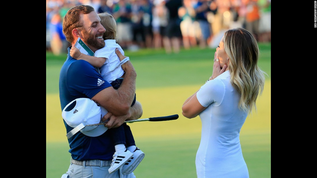 "Dustin Johnson celebrates <a href=""http://www.cnn.com/2016/06/19/golf/golf-us-open-johnson-penalty-lowry/"" target=""_blank"">his U.S. Open victory</a> with his fiancee, Paulina Gretzky, and their son, Tatum, on Sunday, June 19. It was the first major victory for Johnson, who finished second in the U.S. Open last year."