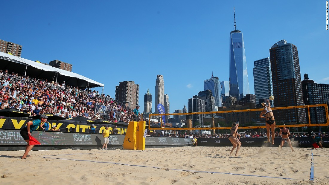 April Ross spikes the ball during a beach volleyball tournament in New York City on Saturday, June 18. Ross and her partner, Kerri Walsh Jennings, won the event.