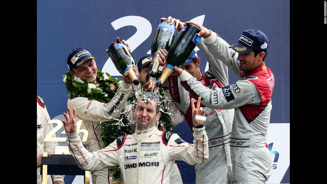 Romain Dumas has champagne dumped on his head after he and Porsche teammates Neel Jani and Marc Lieb won the 24 Hours of Le Mans on Sunday, June 19. The endurance race is held annually in western France.