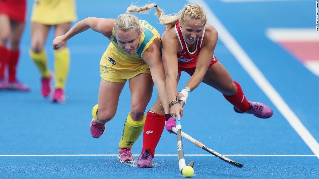 Australia's Jane Claxton, left, battles with American Kelsey Kolojejchick during a Hockey Champions Trophy match in London on Saturday, June 18. The match ended 2-2.