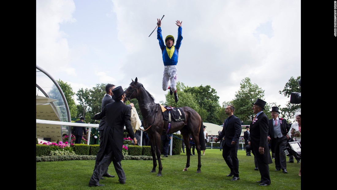 Frankie Dettori dismounts from Across the Stars after winning a race in Ascot, England, on Friday, June 17.