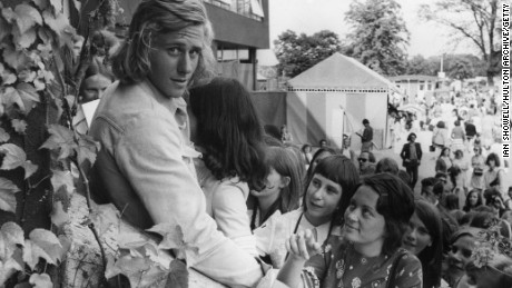 Swedish tennis player Bjorn Borg is mobbed by fans at Wimbledon in 1973.