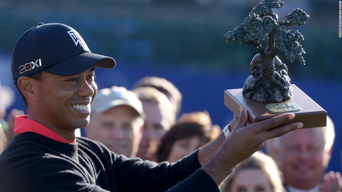 Woods holds the trophy for the Farmers Insurance Open at Torrey Pines in January 2013, where he clinched his 75th PGA Tour title.