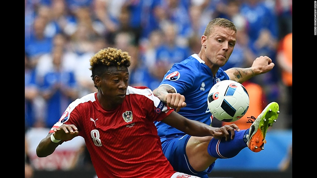 Austrian midfielder David Alaba competes against Icelandic defender Ragnar Sigurdsson.