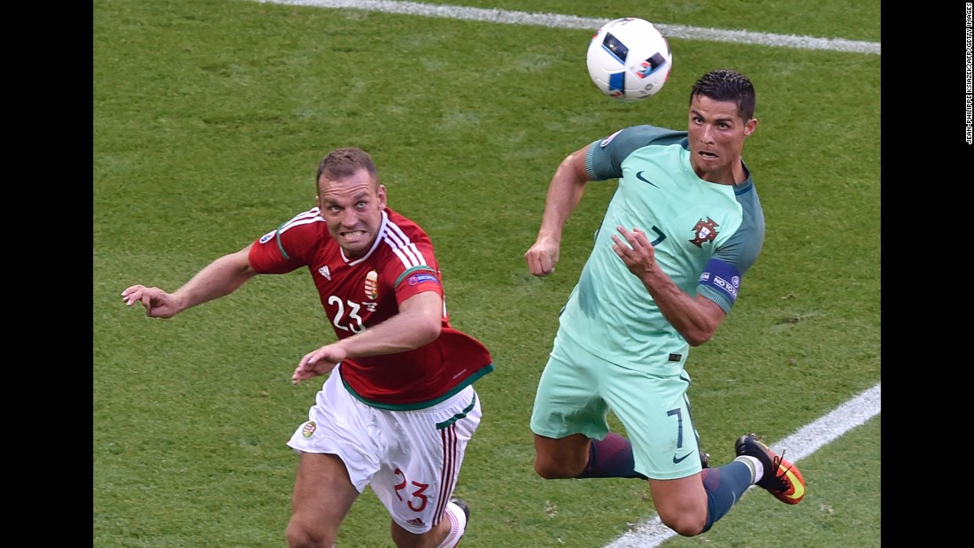 Portugal star Cristiano Ronaldo, right, heads in his second goal of the match. Portugal finished third in Group F and will play Croatia in the round of 16.