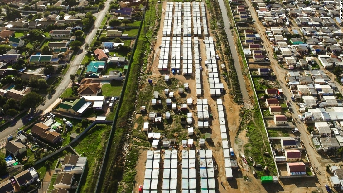 "The townships, notes Miller, are made up of quickly built shacks. ""There is only one entrance and exit so it's always clogged with people and buses"" he says of Masiphumelele. This makes a stark contrast to the well-planned neighborhood next door ""which has a tenth of the people and very good transport links."""