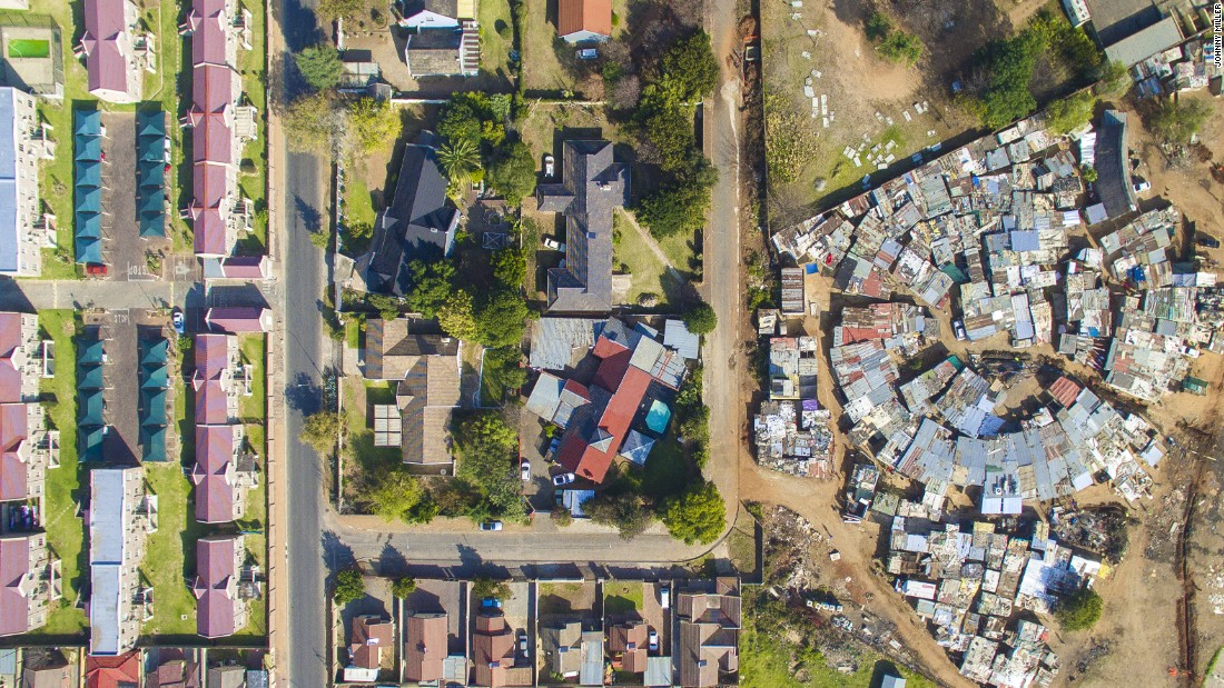 "When Miller tried to access Cape Town's more affluent areas, he was stopped by security guards. ""You have two or three meter high fences with electric fencing and often barbed wire, which is the norm for South Africa"", he says. His drone shots allowed him to bypass security."