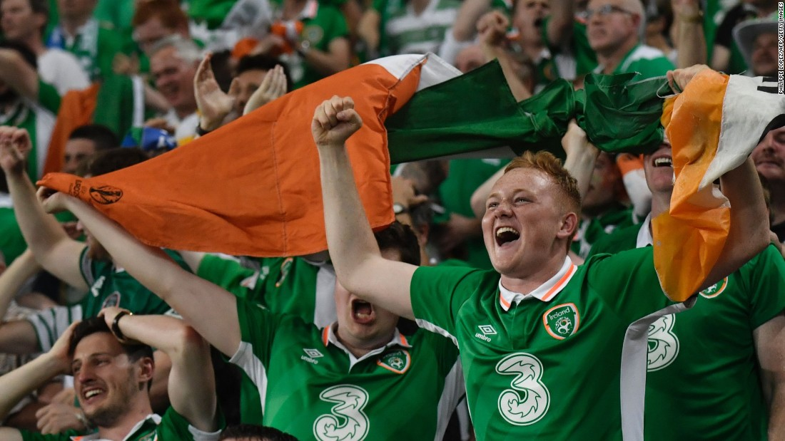Irish supporters are jubilant following Brady's crucial goal.
