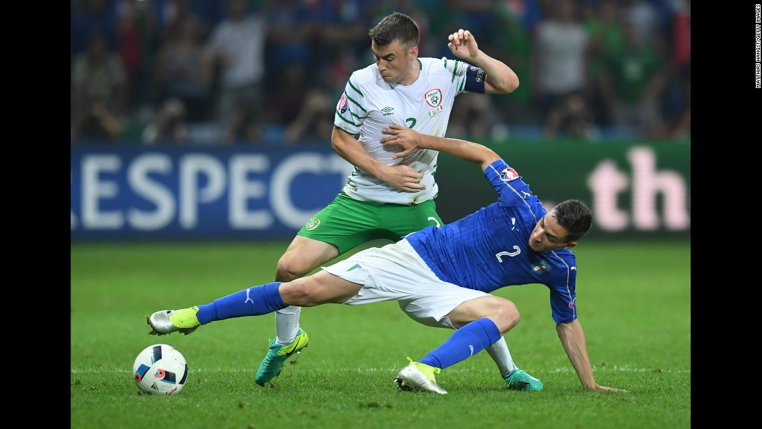 Ireland's Seamus Coleman, top, battles Italy's Mattia De Sciglio for possession of the ball.
