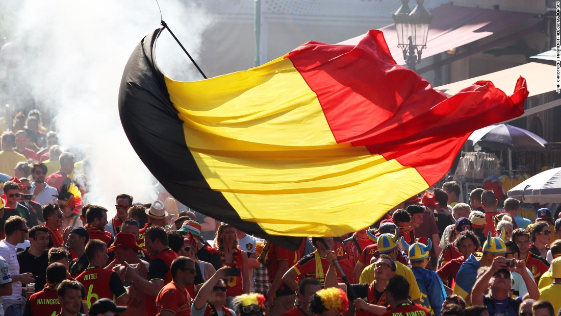 A person waves a Belgian flag before the match.