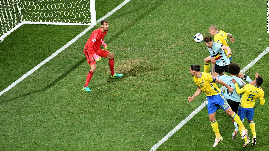 Swedish goalkeeper Andreas Isaksson prepares to stop a header.