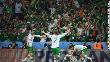 Ireland's players celebrate with supporters after Robbie Brady's late strike.