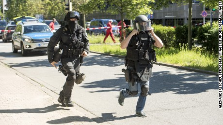 VIERNHEIM, GERMANY - JUNE 23: Heavily-armed police outside a movie theatre complex where an armed man has reportedly opened fire on June 23, 2016 in Viernheim, Germany. According to initial media reports, the man entered the cinema today at approximately 3pm, fired a shot in the air and barricaded himself inside. (Photo by Alexander Scheuber/Getty Images)