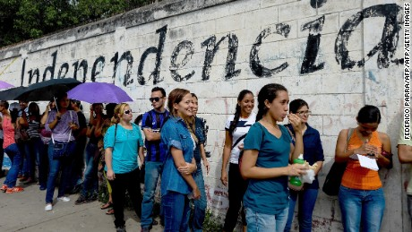 "Venezuelans line up to authenticate their signatures for a recall referendum before the National Electoral Council (CNE) in Maracay, Venezuela on June 23, 2016. Venezuela is interested in improving its rocky relations with the United States, and hopes President Barack Obama will ""rectify"" US policy toward the crisis-torn South American country, its president Nicolas Maduro said Wednesday. / AFP / FEDERICO PARRA        (Photo credit should read FEDERICO PARRA/AFP/Getty Images)"