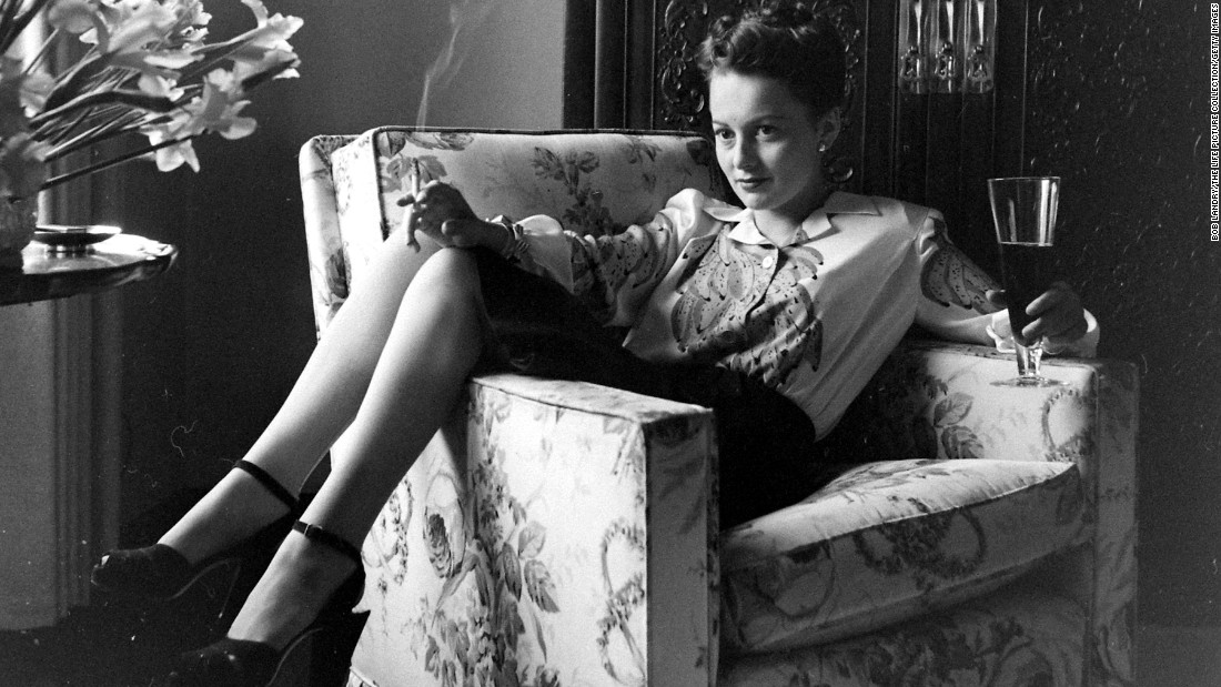 "<a href=""http://www.cnn.com/2013/01/21/us/olivia-de-havilland-fast-facts/"">Olivia de Havilland</a> remains one of the last survivors of Hollywood's glamorous heyday of the 1930s and '40s. The star celebrates her 100th birthday on Friday, July 1. De Havilland, the personification of kind and genteel ladies in the movies, initially wanted to be a schoolteacher. But she began acting professionally at 18 and enjoyed a career that spanned from the mid-'30s to the late '80s. Here, in an uncharacteristic pose, she relaxes at home with a cigarette and beer in the early 1940s."
