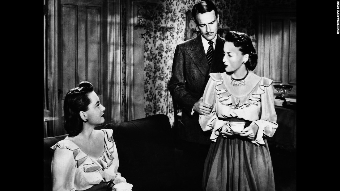 "De Havilland almost always played sympathetic parts, but her dual roles as twins in the thriller ""The Dark Mirror"" (1946) proved to be an exception. Lew Ayres, center, was a psychiatrist trying to figure out which twin was a disturbed murderess."