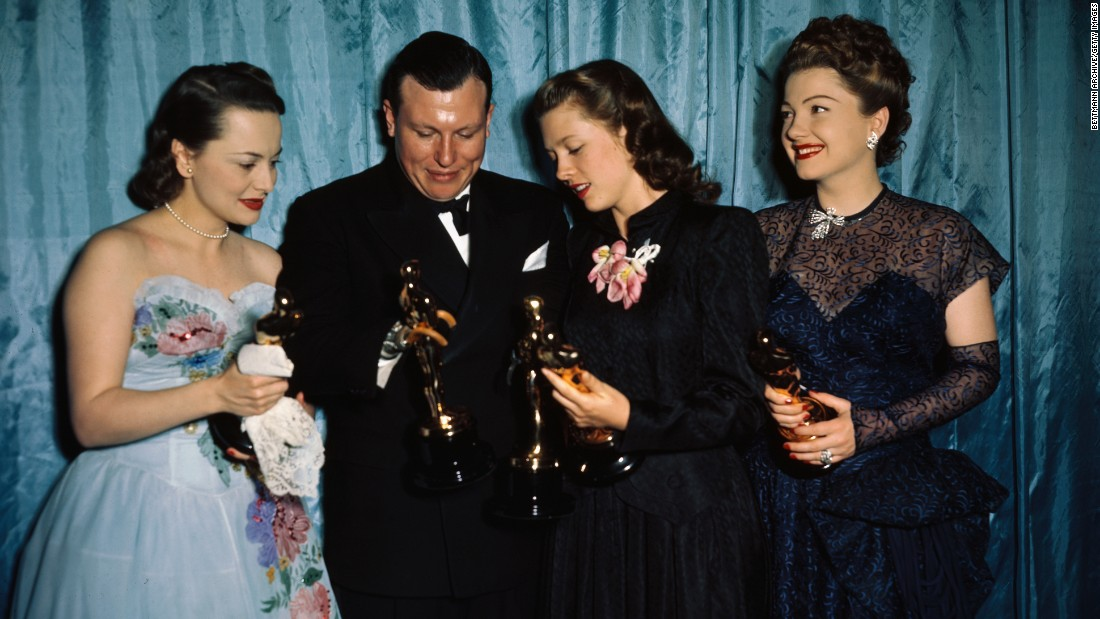 "The actress, far left, appears in the winners' circle with Harold Russell, Cathy O'Donnell and Anne Baxter at the Academy Awards in 1947. De Havilland won for ""To Each His Own,"" while Russell picked up the best supporting actor Oscar and an honorary award for playing a disabled veteran in best picture winner ""The Best Years of Our Lives,"" featuring O'Donnell as his girlfriend. Baxter, right, was best supporting actress for ""The Razor's Edge."""