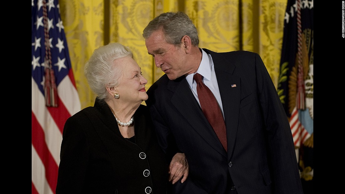 "U.S. President George W. Bush presents de Havilland with the National Medal of Arts at the White House in November 2008. <a href=""https://www.arts.gov/honors/medals/olivia-de-havilland"" target=""_blank"">The star was recognized</a> ""for her lifetime achievements and contributions to American culture as an actress."""