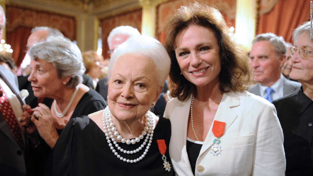 "De Havilland and fellow actress Jacqueline Bisset receive the Legion of Honor, one of France's top awards, at the Élysée Palace in Paris in September 2010. The ""Gone With the Wind"" star has called the French capital home for six decades."