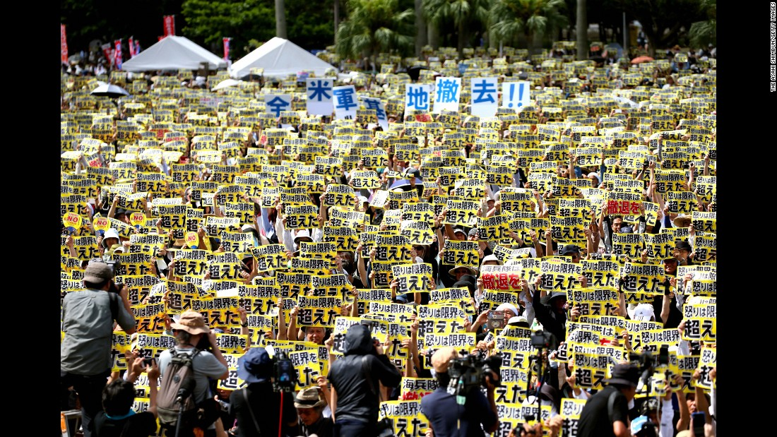 "People hold signs that say ""anger going beyond limits"" during a demonstration in Naha, Japan, on Sunday, June 19. Tens of thousands of people have demanded an end to the United States' military presence on the Japanese island of Okinawa <a href=""http://www.cnn.com/2016/06/20/asia/us-military-base-protests-okinawa/"" target=""_blank"">following the killing of a local woman.</a> Kenneth Franklin Shinzato, a 32-year-old civilian worker who was stationed at the U.S. Kadena Air Base, was arrested on suspicion of murdering the woman."
