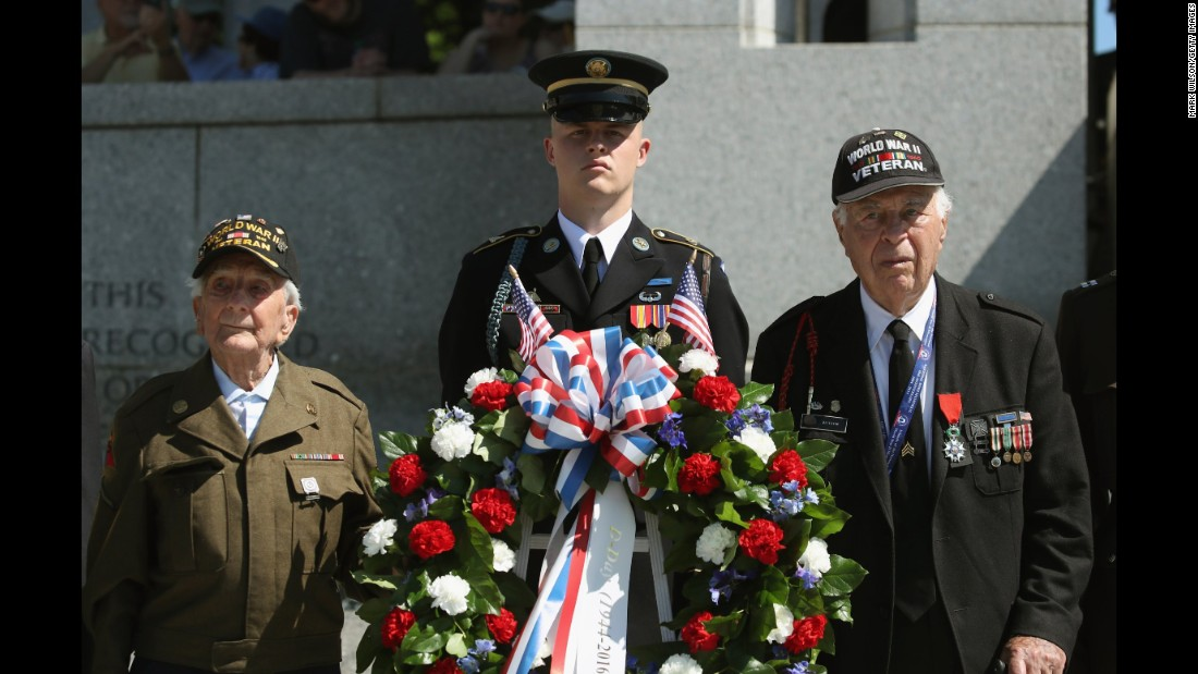 "D-Day veterans George Krakosky, left, and Herman Zeitchik, right, attend a wreath-laying ceremony at the National World War II Memorial on Monday, June 6. D-Day was the largest amphibious invasion in history. On June 6, 1944, more than 160,000 Allied troops -- about half of them Americans -- <a href=""http://www.cnn.com/2012/06/05/world/gallery/d-day/index.html"" target=""_blank"">invaded Western Europe,</a> overwhelming German forces in an operation that proved to be a turning point in World War II."