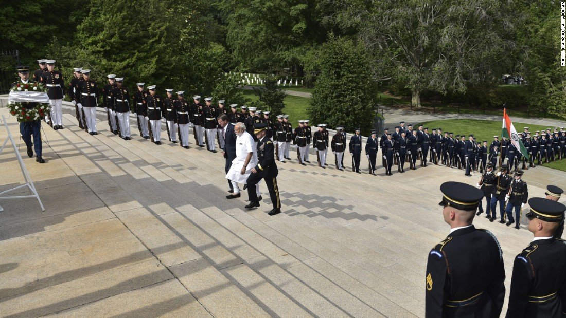 "Indian Prime Minister Narendra Modi, in white, arrives for a wreath-laying ceremony at Arlington National Cemetery on Monday, June 6. He is accompanied by U.S. Defense Secretary Ashton Carter and U.S. Army. Maj. Gen. Bradley Becker. Modi <a href=""http://www.cnn.com/2016/06/07/world/gallery/modi-us-visit/index.html"" target=""_blank"">was in Washington</a> for a three-day visit."