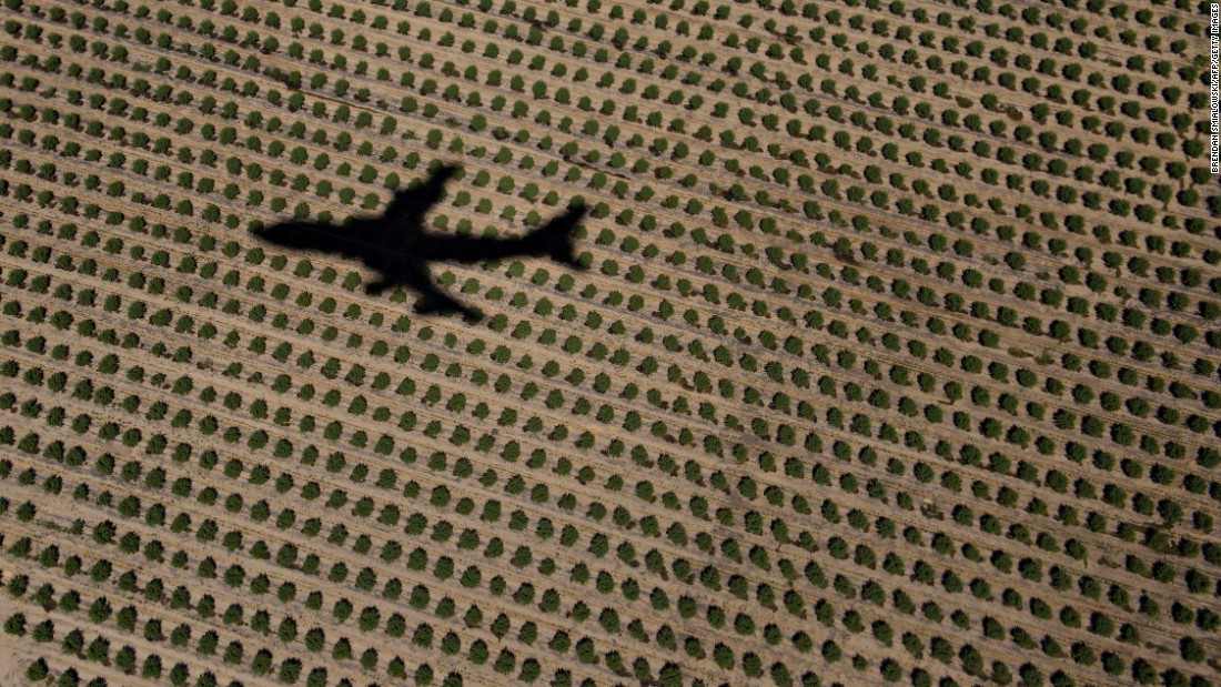The shadow of Air Force One is seen on farmland as it takes off in Merced County, California, on Sunday, June 19.