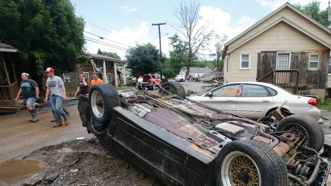 Overturned cars litter the street in White Sulphur Springs on June 24.