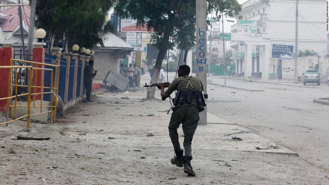 "A Somali soldier takes position on the street near the scene of the attack, which comes three weeks after suspected Al-Shabaab gunmen <a href=""http://www.cnn.com/2016/06/01/africa/somalia-mogadishu-ambassador-hotel-siege/"" target=""_blank"">set off an explosion</a> and stormed another popular Mogadishu hotel, killing at least 13 people, according to security officials. Three attackers were also killed."
