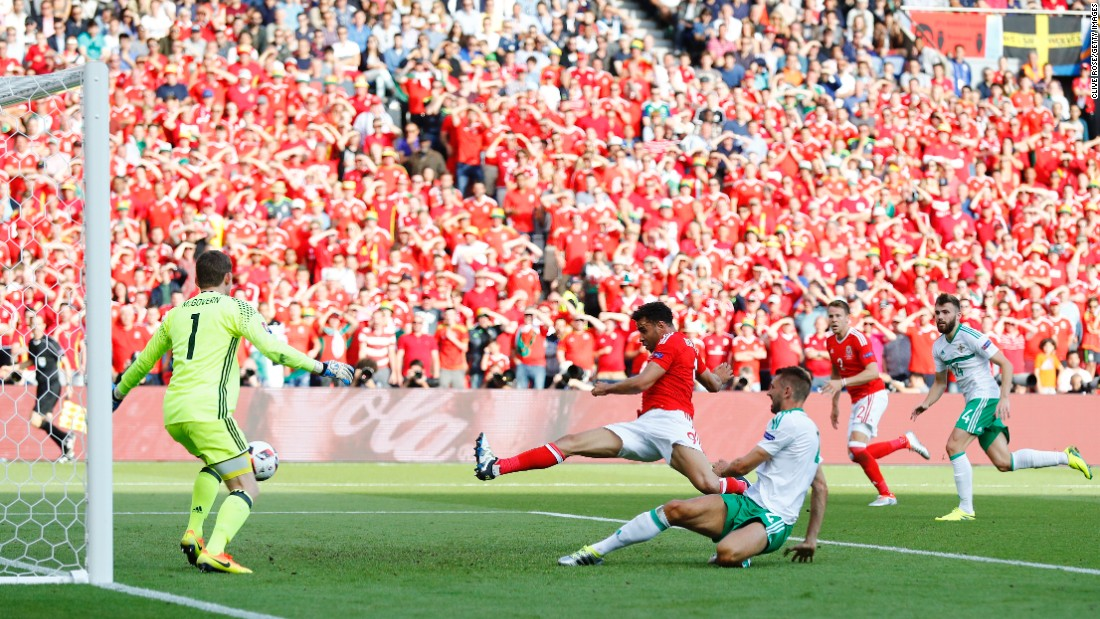 Gareth McAuley, third right, of Northern Ireland scores an own goal past Michael McGovern, first left.