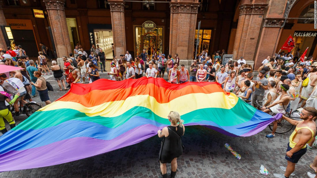 Marchers walk with a giant rainbow flag during the Pride parade in Bologna, Italy, on June 25.