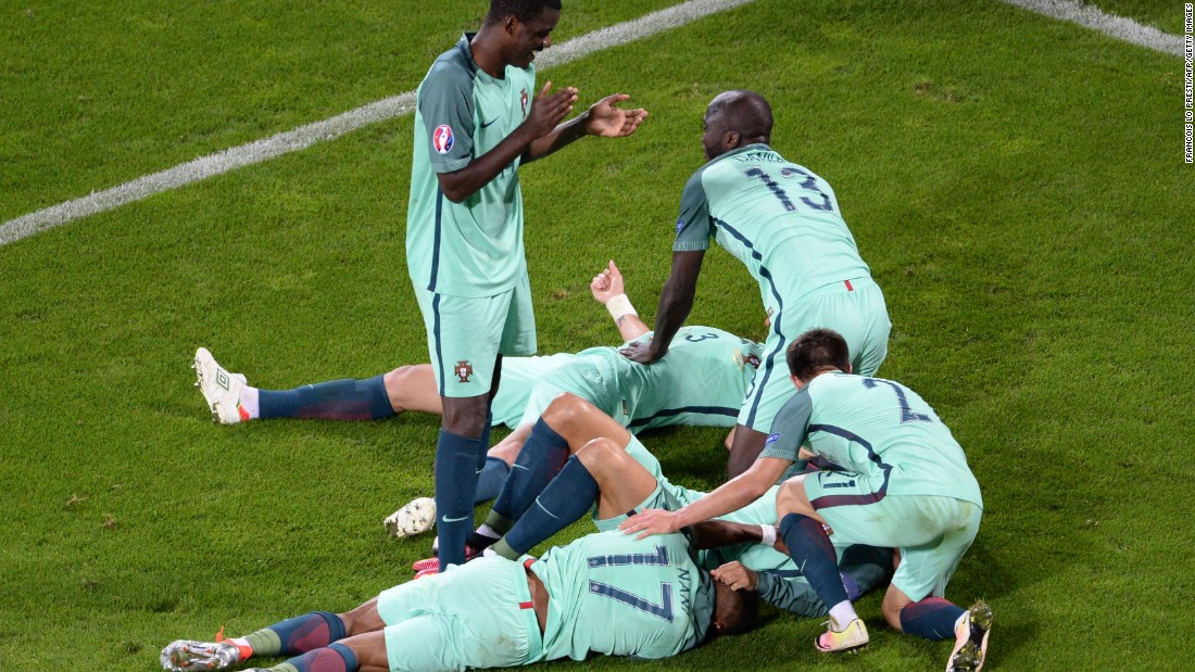 Portugal players celebrate at the end of the match.