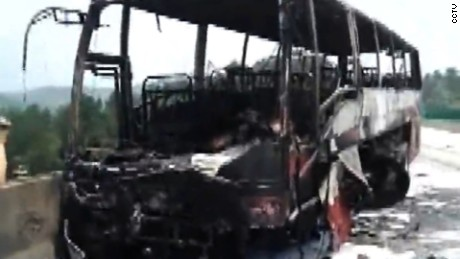 This bus burst into flames after crashing into guardrails in central China's Hunan Province Sunday morning.